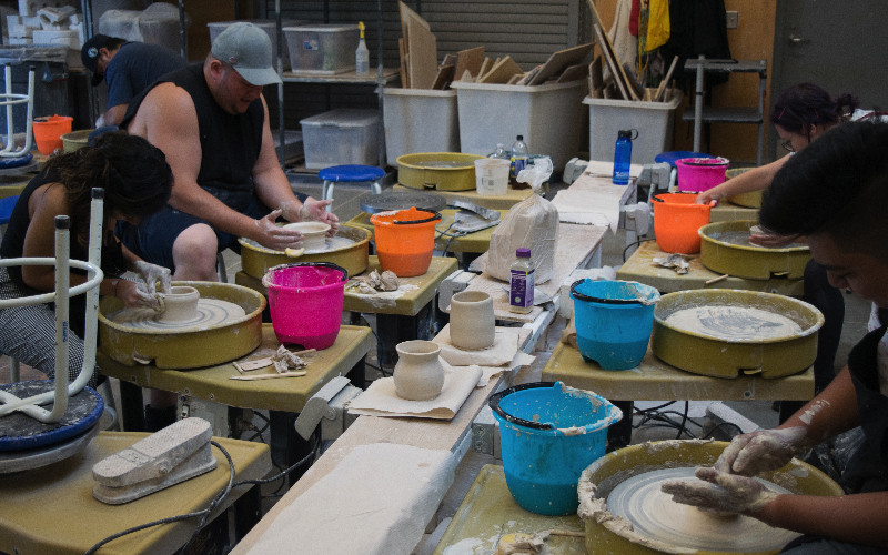 Ceramic students in studio