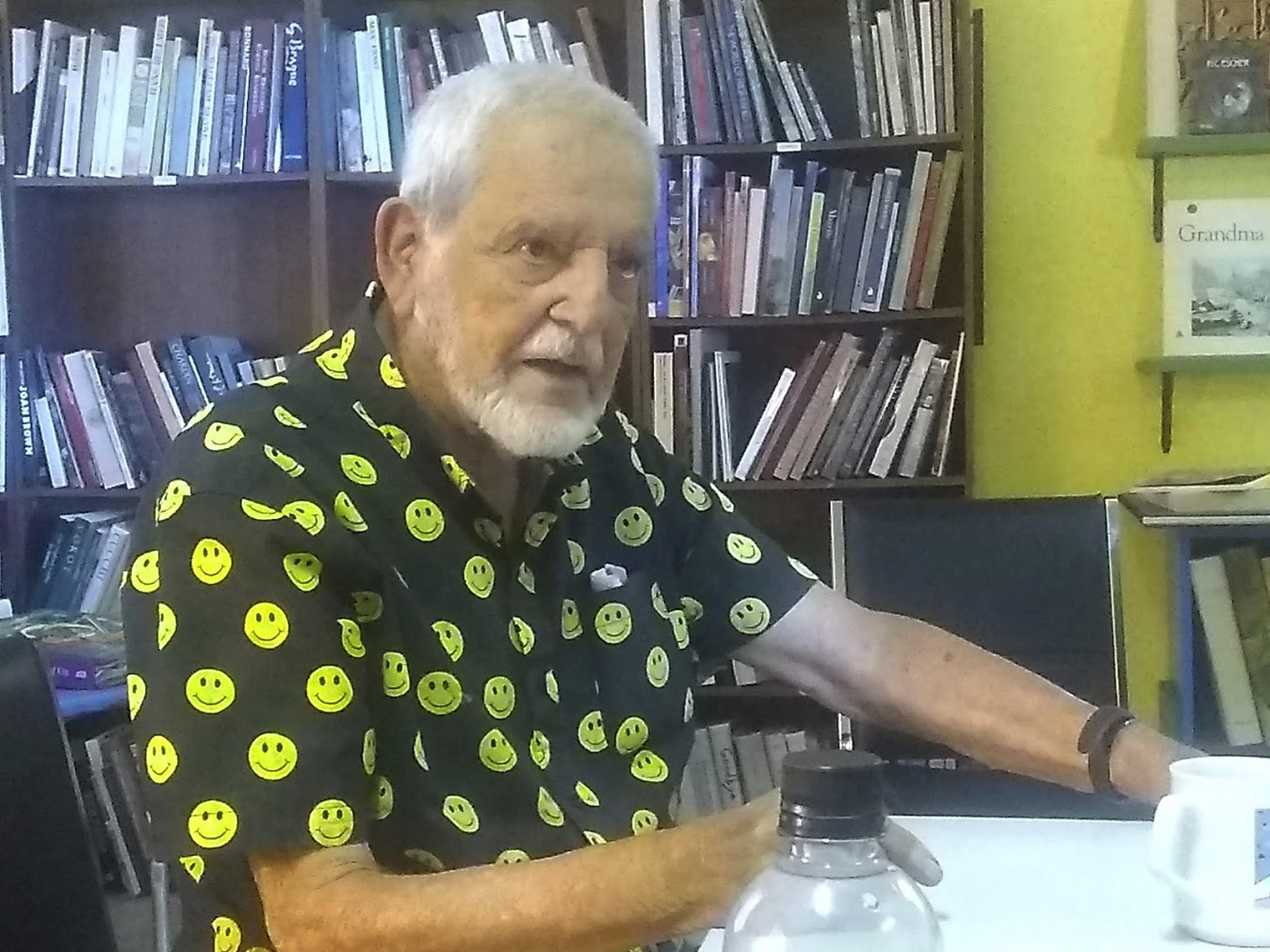 Dr. Ernest Garcia, black shirt with yellow smiley faces and silver hair