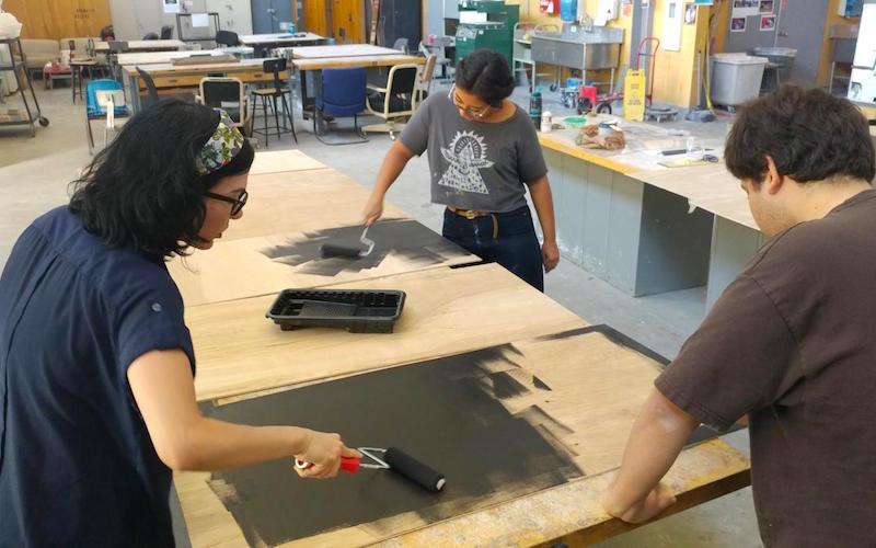 Sculpture students preparing elements of a collaborative work