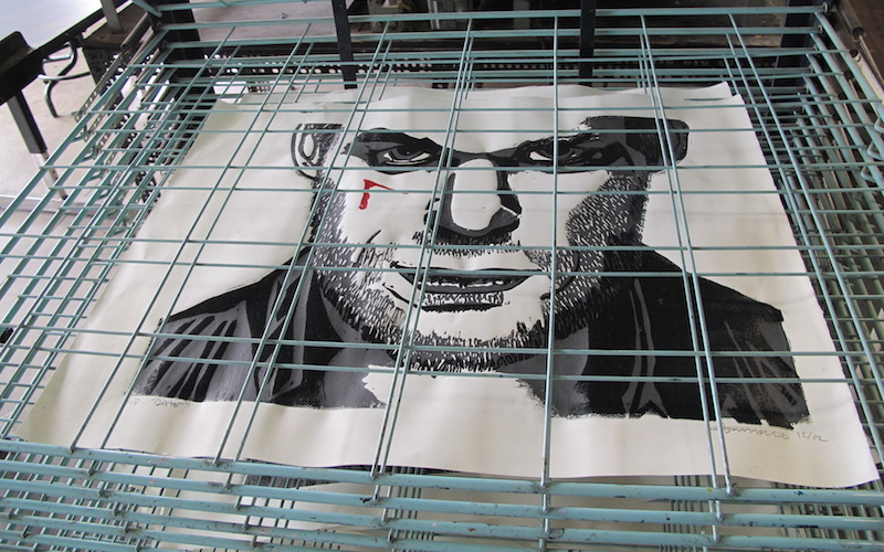 Screenprint of Dexter on the drying rack