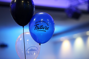 Photo of balloons with We Define the Future logo