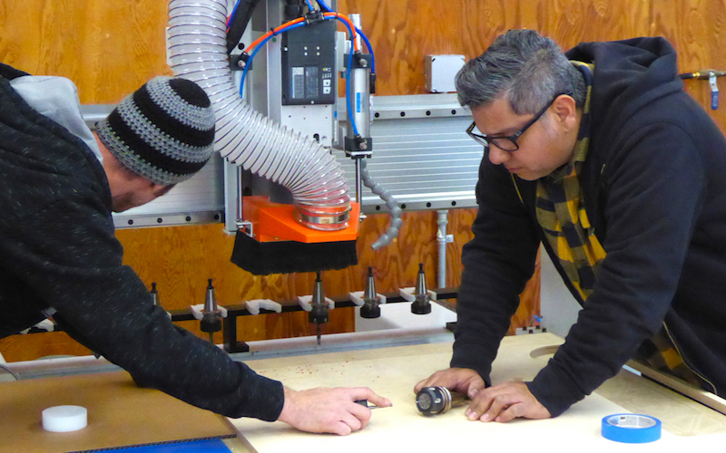 Professor Edward Gomez and Technician Ryan Clark setting up the CNC Router
