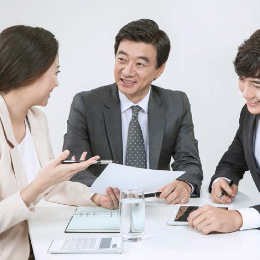 three business individuals in a meeting