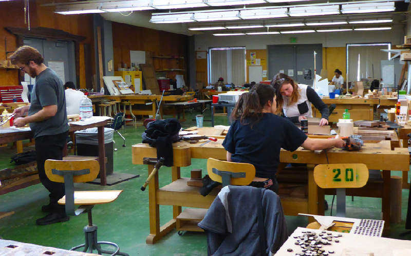 Students working in wood studio.