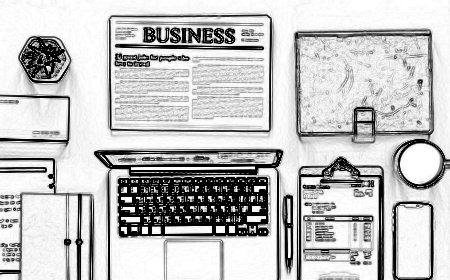 desktop with computer planner and newspaper business section