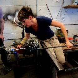 "A distinguished glass artist, art professor Katherine Gray was selected as a Fellow of the American Craft Council and serves as a resident evaluator on the Netflix show ""Blown Away."""