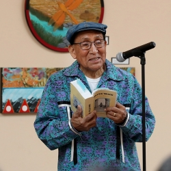 Carolyn Horsman (left) and Ernest Siva, elder of Morongo Band of Mission Indians, at the annual Native Voices Poetry Festival at the Dorothy Ramon Learning Center in Banning in February.