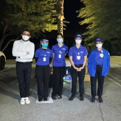 Four CSUSB Palm Desert Campus nursing students (in the blue tops) provide flu shots at a drive-thru flu shot clinic at the North Shore Beach and Yacht Club at the Salton Sea.