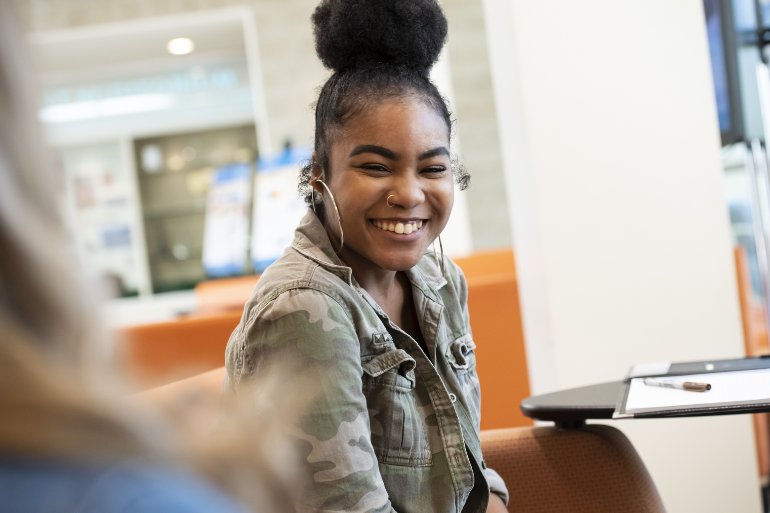 Student smiling during conversation.