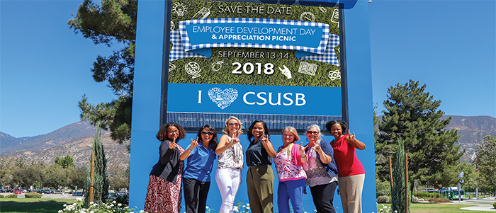 EDD2018 team members pose in front of CSUSB Marquee