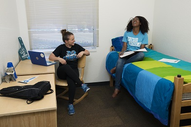 two students in Arrowhead Village room