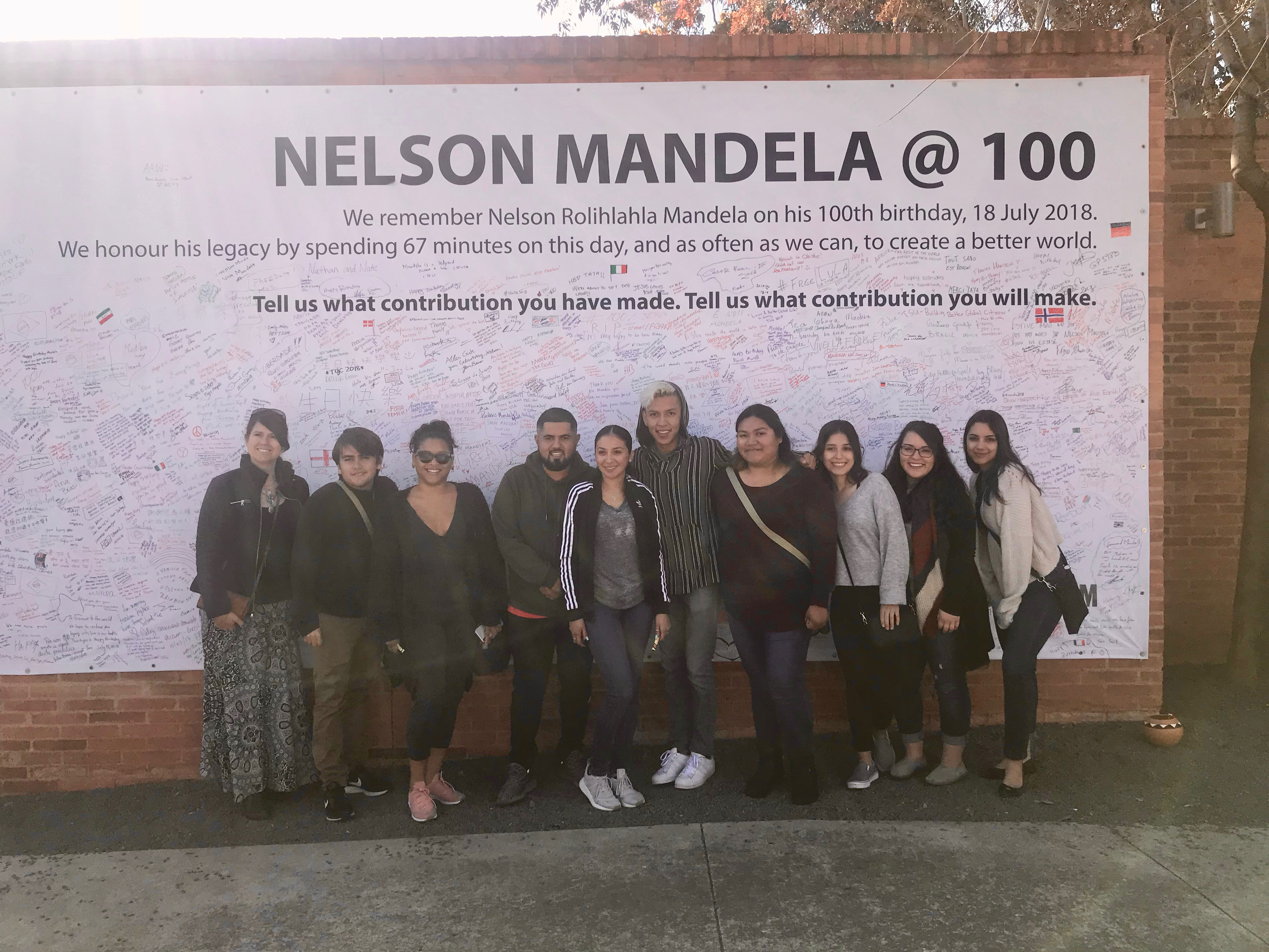 CSUSB Students in Front of Nelson Mandela @100 Banner