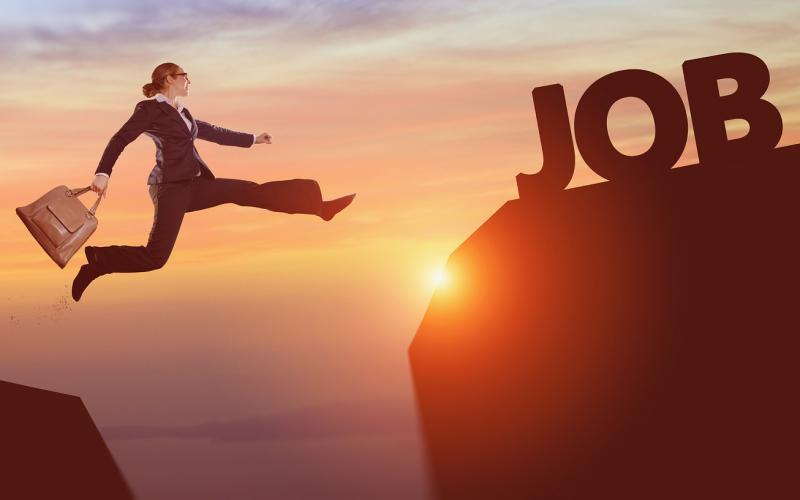 Woman jumping over gap to the word Job