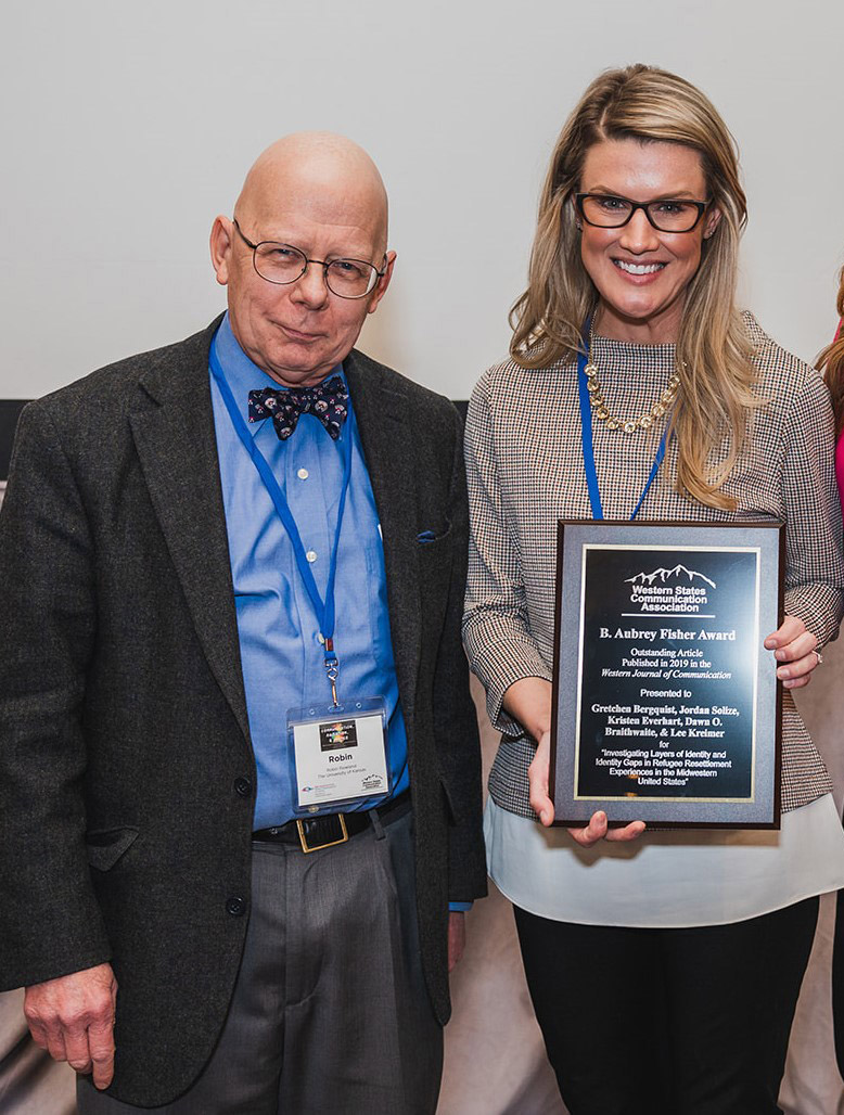 From left, Fisher Award Committee Chair Robin Rowland with Gretchen Bergquist CSUSB