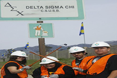 Members of Delta Sigma Chi doing service
