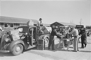 Baggage of Japanese-Americans being inspected as they arrive